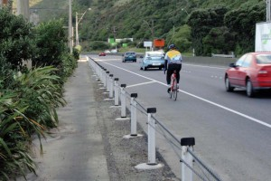 Cyclist on shoulder of SH2 between Petone and Ngauranga (NZTA photo)